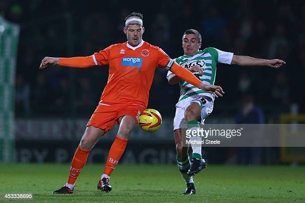 Adam Morgan of Yeovil Town challenges Gary Mackenzie of Blackpool during the Sky Bet Championship match between Yeovil Town and Blackpool at Huish...