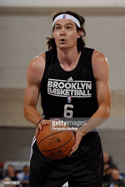 Adam Morrison of the Brooklyn Nets shoots a foul shot against the Orlando Magic during the 2012 Air Tran Airways Orlando Pro Summer League on July 11...