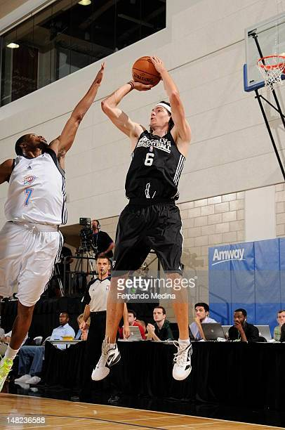 Adam Morrison of the Brooklyn Nets shoots against Marquez Haynes of the Oklahoma City Thunder during the 2012 Air Tran Airways Orlando Pro Summer...