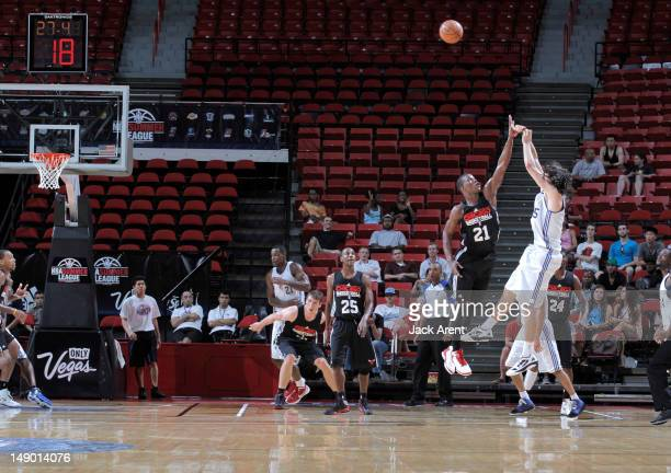 Adam Morrison of the Los Angeles Clippers shoots against Jimmy Butler of the Chicago Bulls during NBA Summer League on July 21 2012 at Thomas Mack...
