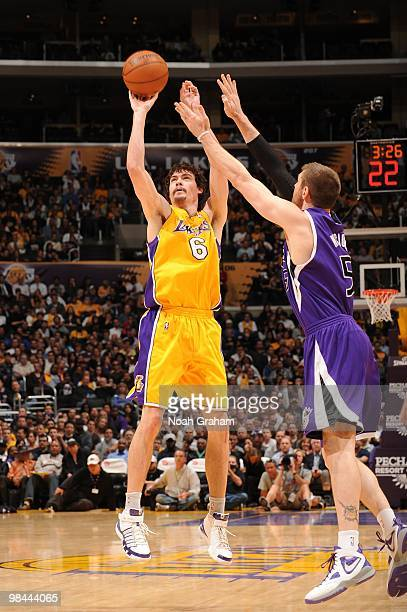 Adam Morrison of the Los Angeles Lakers shoots against Andres Nocioni of the Sacramento Kings at Staples Center on April 13 2010 in Los Angeles...