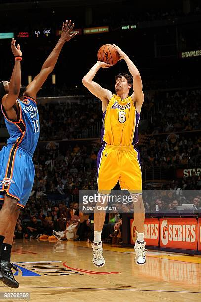 Adam Morrison of the Los Angeles Lakers shoots against James Harden of the Oklahoma City Thunder in Game Five of the Western Conference Quarterfinals...