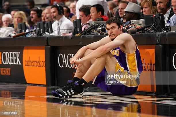 Adam Morrison of the Los Angeles Lakers waits to enter the game in front of the scorer's table during the game against the Sacramento Kings at Arco...