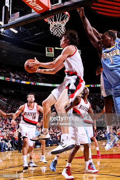 Adam Morrison of the Portland Trail Blazers goes to the basket against Jordan Hamilton of the Denver Nuggets during a preseason game on October 17...