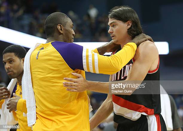Adam Morrison of the Portland Trail Blazers greets Metta World Peace of the Los Angeles Lakers after the game at Citizens Business Bank Arena on...