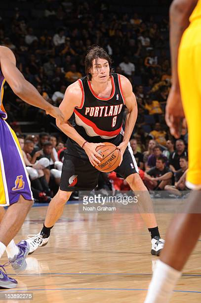Adam Morrison of the Portland Trail Blazers looks to pass the ball against the Los Angeles Lakers during a preseason game at Citizens Business Bank...