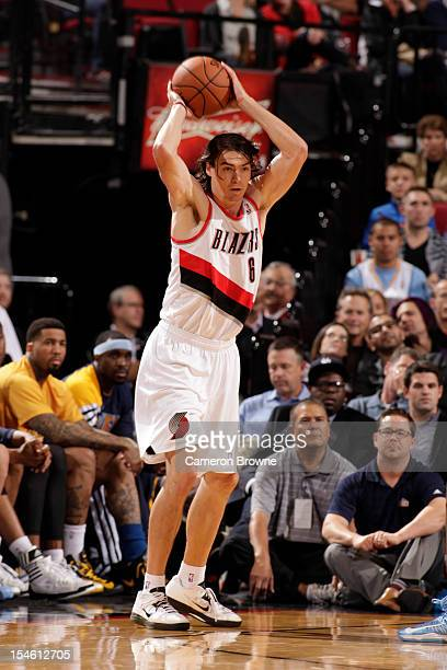 Adam Morrison of the Portland Trail Blazers passes the ball against the Denver Nuggets on October 17 2012 at the Rose Garden Arena in Portland Oregon...