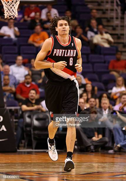 Adam Morrison of the Portland Trail Blazers runs up court during the preseason NBA game against the Phoenix Suns at US Airways Center on October 12...
