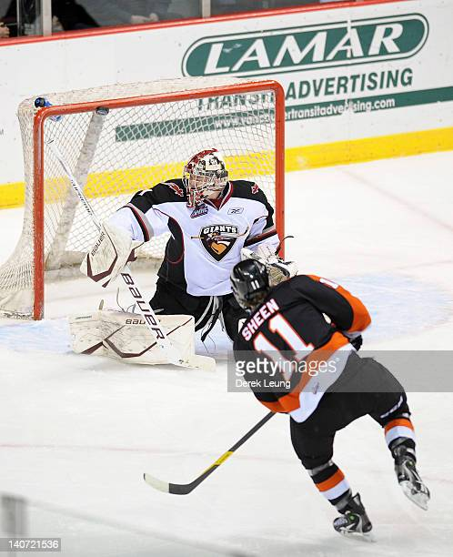 Adam Morrison of the Vancouver Giants blocks the shot of Riley Sheen of the Medicine Hat Tigers in WHL action on March 2 2012 at Pacific Coliseum in...