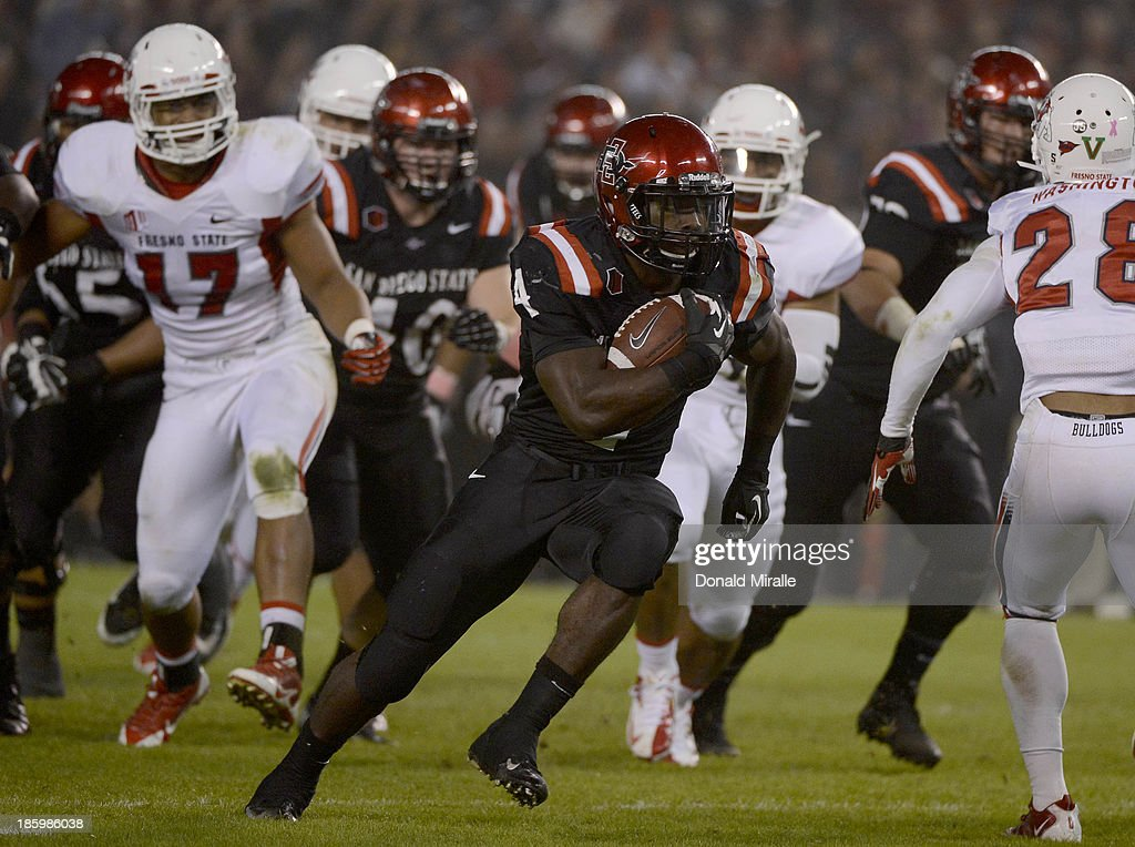 Adam Muema #4 of San Diego State Aztecs runs for a touchdown against the Fresno State Bulldogs during their game on October 26, 2013 at Qualcomm Stadium in San Diego, California.