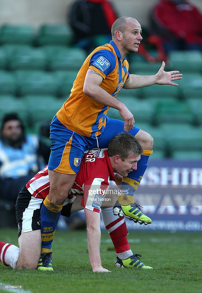 Adam Murray of Mansfield Town attempts to climb over Alan Power of Lincoln City during the FA Cup with Budweiser Second Round match at Sincil Bank Stadium on December 1, 2012 in Lincoln, England.