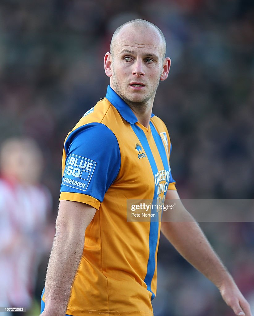 Adam Murray of Mansfield Town in action during the FA Cup with Budweiser Second Round match at Sincil Bank Stadium on December 1, 2012 in Lincoln, England.