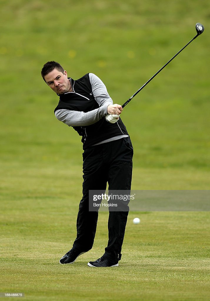 Adam Myers of Northants County Golf Club hits his approach into the 18th hole during the Powerade PGA Assistants' Championship Regional Qualifier at the Henley Golf and Country Club on May 09, 2013 in Henley-in-Arden, England.