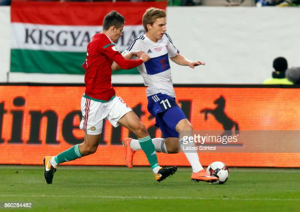 Adam Nagy of Hungary competes for the ball with Joan Edmundsson of Faroe Islands during the FIFA 2018 World Cup Qualifier match between Hungary and...