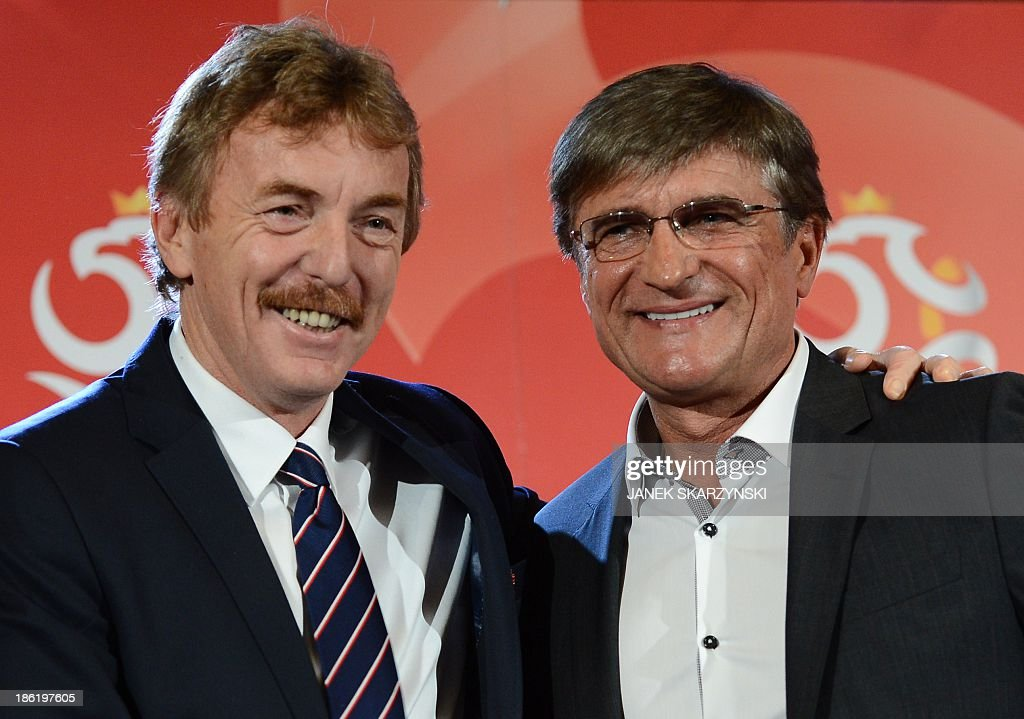 Adam Nawalka (R), new coach of the Polish national football team is congratulated by Zbigniew Boniek, head of Polish football federation during a press conference in Warsaw, Poland on October 29, 2013. Former Polish international Adam Nawalka has been named as the country's new coach, replacing the sacked Waldemar Fornalik.