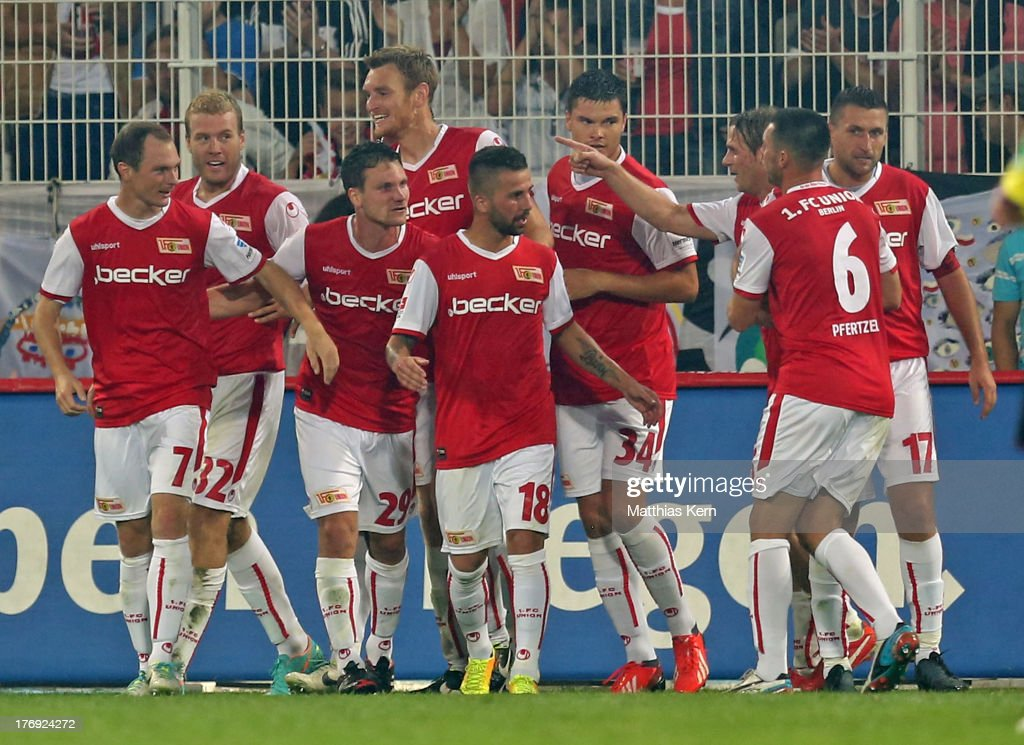 Adam Nemec (L) of Berlin jubilates with team mates after scoring the first goal during the Second Bundesliga match between 1.FC Union Berlin and Fortuna Duesseldorf at Stadion an der Alten Foersterei on August 19, 2013 in Berlin, Germany.