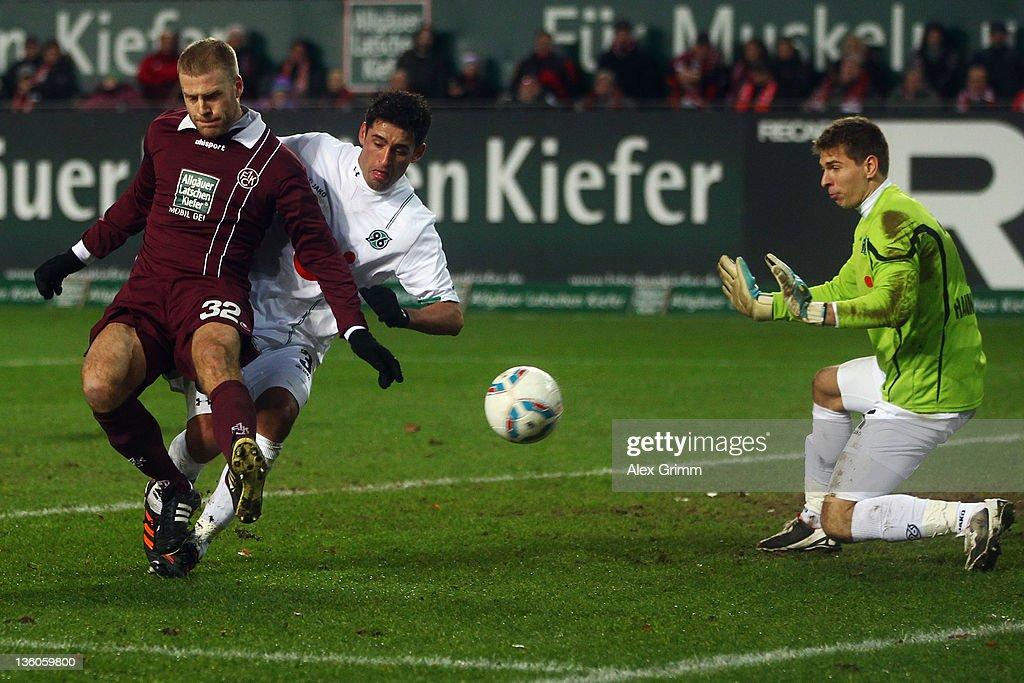 Adam Nemec of Kaiserslautern tries to score against Karim Haggui and goalkeeper Ron-Robert Zieler (L-R) of Hannover during the Bundesliga match between 1. FC Kaiserslautern and Hannover 96 at Fritz-Walter Stadium on December 18, 2011 in Kaiserslautern, Germany.