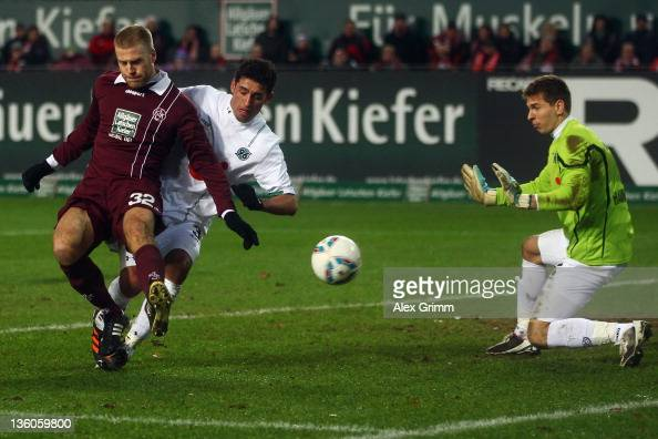 Adam Nemec of Kaiserslautern tries to score against Karim Haggui and goalkeeper RonRobert Zieler of Hannover during the Bundesliga match between 1 FC...