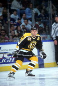 Adam Oates of the Boston Bruins skates on the ice during an NHL game against the New York Islanders on December 26 1995 at the Nassau Coliseum in...
