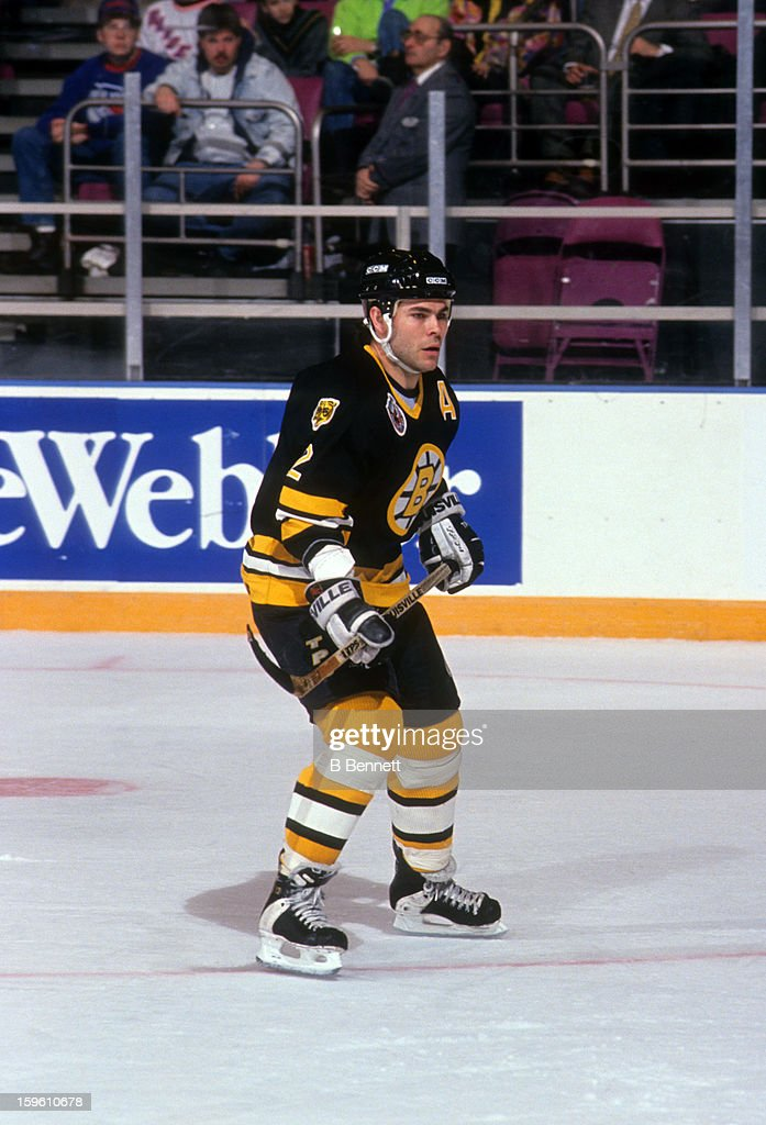 Adam Oates of the Boston Bruins skates on the ice during an NHL game against the New York Rangers on March 15 1993 at the Madison Square Garden in...
