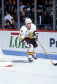 Adam Oates of the Boston Bruins skates on the ice during an NHL game against the Montreal Canadiens on April 15 1992 at the Montreal Forum in...