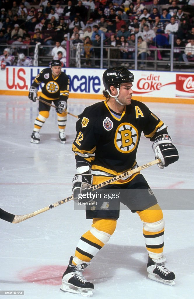 Adam Oates of the Boston Bruins skates on the ice during an NHL game against the New York Rangers on December 27 1992 at the Madison Square Garden in...