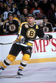 Adam Oates of the Boston Bruins skates on the ice during an NHL game against the Phildelphia Flyers circa 1996 at the Wells Fargo Center in...