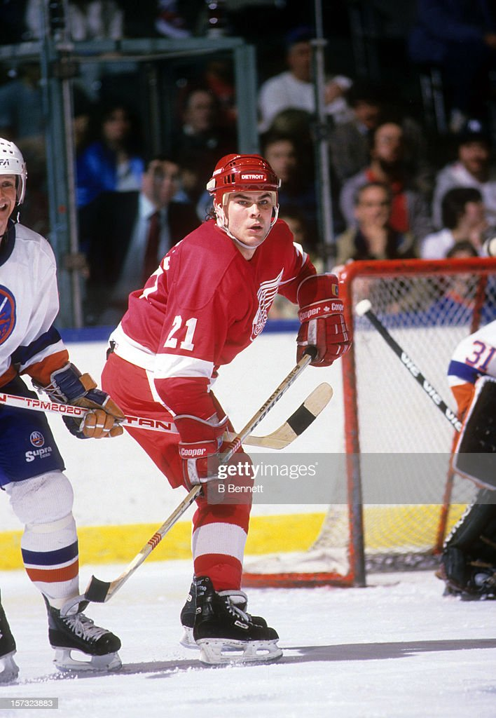 Adam Oates of the Detroit Red Wings skates on the ice during an NHL game against the New York Islanders circa 1988 at the Nassau Coliseum in...