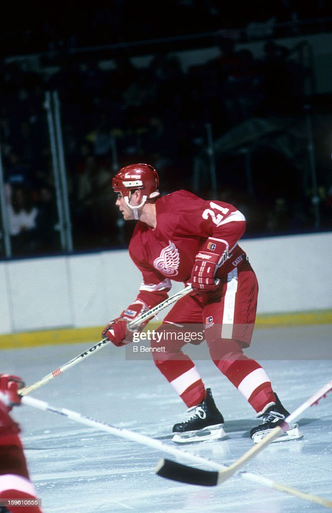 Adam Oates of the Detroit Red Wings skates on the ice during an NHL game against the New York Islanders on November 8 1986 at the Nassau Coliseum in...