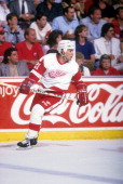 Adam Oates of the Detroit Red Wings skates on the ice during an NHL game circa 1989 at the Joe Louis Arena in Detroit Michigan
