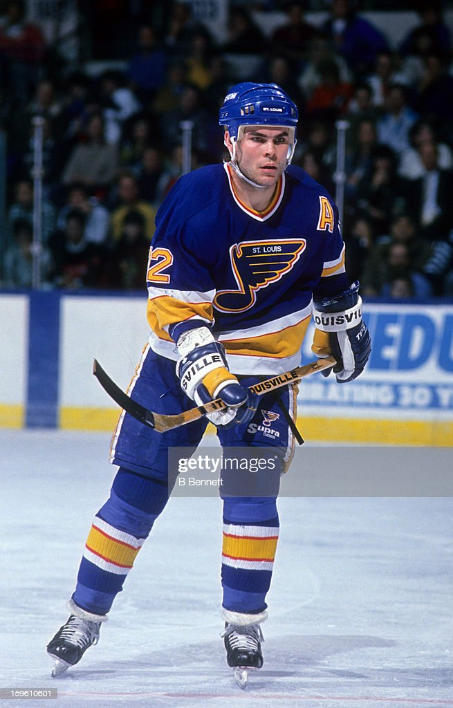 <a gi-track='captionPersonalityLinkClicked' href=/galleries/search?phrase=Adam+Oates&family=editorial&specificpeople=209315 ng-click='$event.stopPropagation()'>Adam Oates</a> #12 of the St. Louis Blues skates on the ice during an NHL game against the New York Islanders circa 1990 at the Nassau Coliseum in Uniondale, New York.
