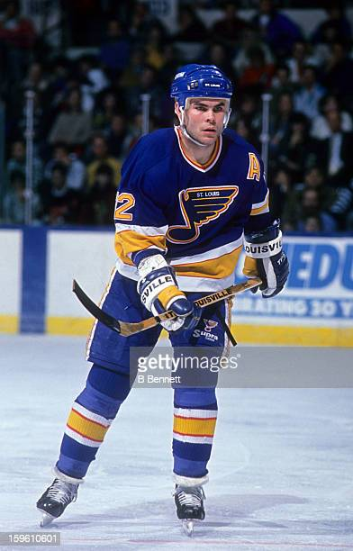 Adam Oates of the St Louis Blues skates on the ice during an NHL game against the New York Islanders circa 1990 at the Nassau Coliseum in Uniondale...