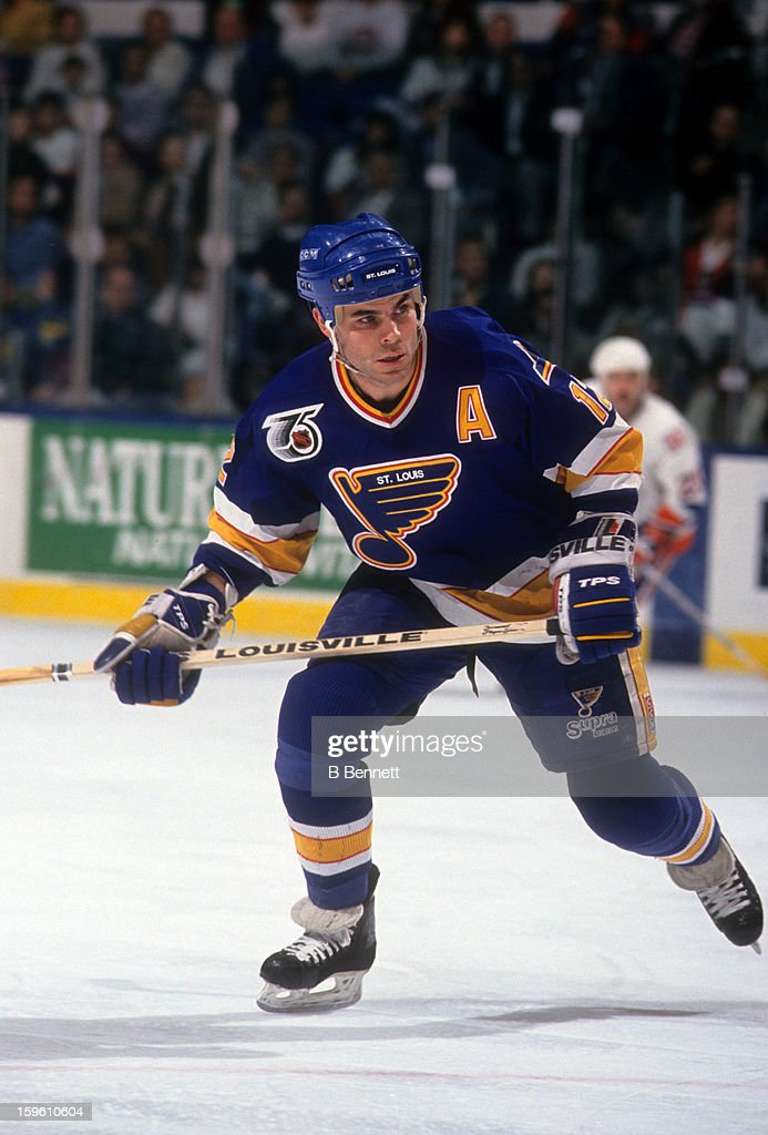 Adam Oates of the St Louis Blues skates on the ice during an NHL game against the New York Islanders on December 10 1991 at the Nassau Coliseum in...