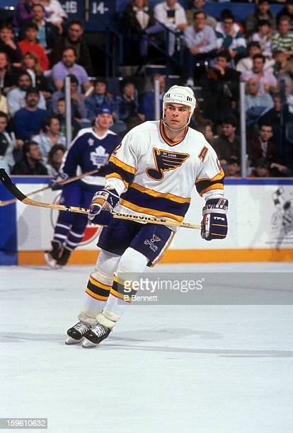 Adam Oates of the St Louis Blues skates on the ice during an NHL game against the Toronto Maple Leafs on March 30 1991 at the St Louis Arena in St...