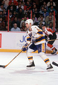 Adam Oates of the St Louis Blues skates with the puck during an NHL game against the Philadelphia Flyers on February 2 1992 at the Spectrum in...