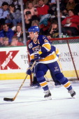 Adam Oates of the St Louis Blues skates with the puck during an NHL game against the Minnesota North Stars on December 28 1991 at the Met Center in...