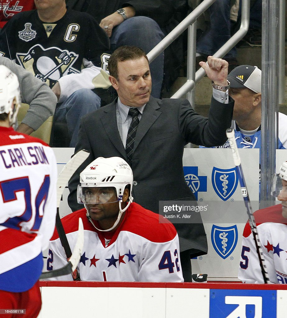 Adam Oates of the Washington Capitals coaches during the game against the Pittsburgh Penguins at Consol Energy Center on March 19, 2013 in Pittsburgh, Pennsylvania.