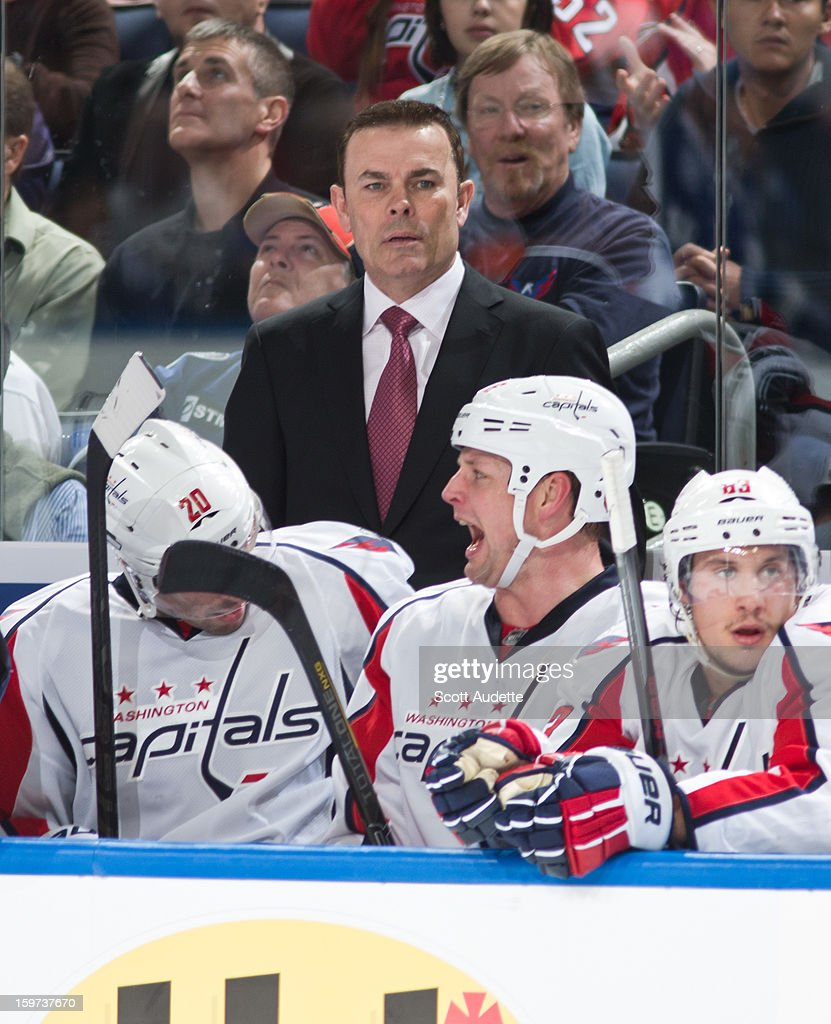 <a gi-track='captionPersonalityLinkClicked' href=/galleries/search?phrase=Adam+Oates&family=editorial&specificpeople=209315 ng-click='$event.stopPropagation()'>Adam Oates</a> of the Washington Capitals coaches from the bench during his first game as head coach against the Tampa Bay Lightning at the Tampa Bay Times Forum on January 19, 2013 in Tampa, Florida.