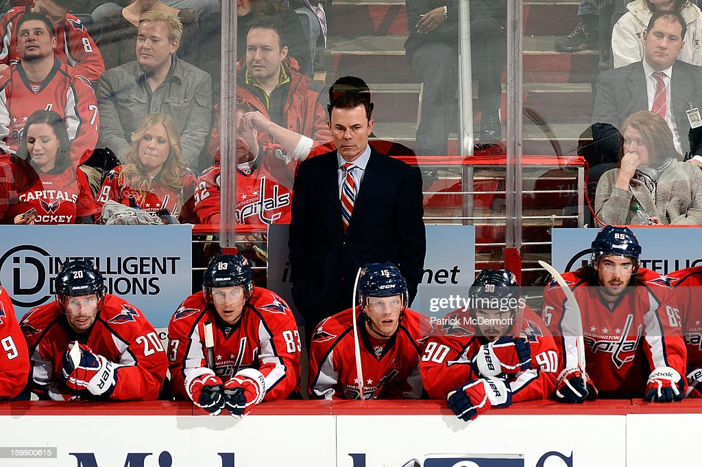 <a gi-track='captionPersonalityLinkClicked' href=/galleries/search?phrase=Adam+Oates&family=editorial&specificpeople=209315 ng-click='$event.stopPropagation()'>Adam Oates</a> of the Washington Capitals look on from the bench during the third period of an NHL hockey game at Verizon Center on January 22, 2013 in Washington, DC.