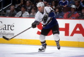 Adam Oates of the Washington Capitals passes the puck during an NHL game in April 1998 at the Capital Centre in Landover Maryland