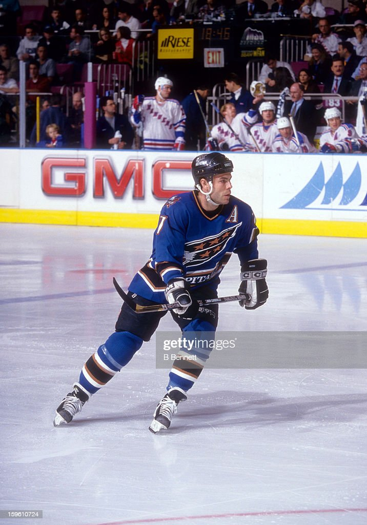 Adam Oates of the Washington Capitals skates on the ice during an NHL game against the New York Rangers on January 8 1998 at the Madison Square...
