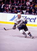 Adam Oates of the Washington Capitals skates on the ice during an NHL game against the New York Rangers circa 1998 at the Madison Square Garden in...