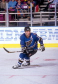 Adam Oates of the Washington Capitals skates on the ice during an NHL game against the New York Rangers on December 2 1997 at the Madison Square...