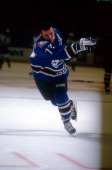 Adam Oates of the Washington Capitals takes a shot during warmups before an NHL game against the Buffalo Sabres on October 9 1997 at the Marine...