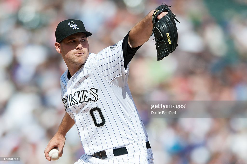 Adam Ottavino #0 of the Colorado Rockies pitches against the Philadelphia Phillies at Coors Field on June 15, 2013 in Denver, Colorado. The Rockies beat the Phillies 10-5.