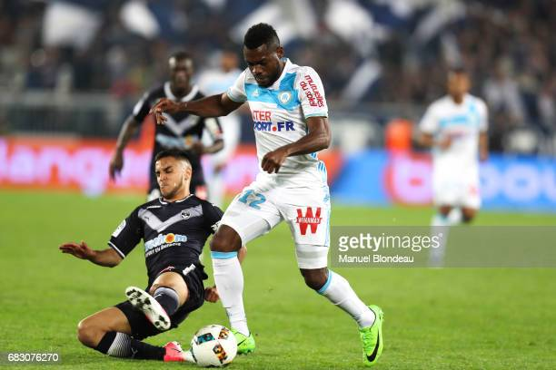 Adam Ounas of Bordeaux and Henri Bedimo of Marseille during the Ligue 1 match between Girondins de Bordeaux and Olympique de Marseille at Nouveau...