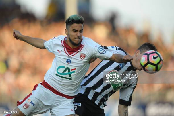 Adam Ounas of Bordeaux and Pierrick Capelle of Angers during the French National Cup Quarter Final match between SCO Angers and Girondins Bordeaux on...