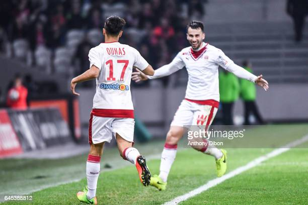 Adam Ounas of Bordeaux celebrates his goal with Milan Gajic during the French Ligue 1 match between Lille and Bordeaux at Stade PierreMauroy on...