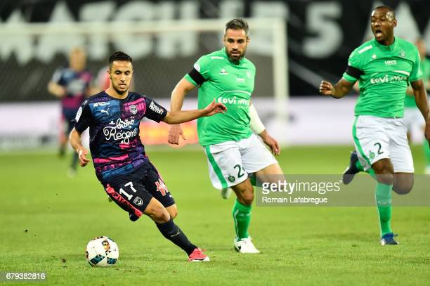 Adam Ounas of Bordeaux Loic Perrin of Saint Etienne during the Ligue 1 match between As Saint Etienne and Girondins de Bordeaux at Stade...