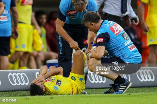 Adam Ounas of Napoli on the ground during the first Audi Cup football match between Atletico Madrid and SSC Napoli in the stadium in Munich southern...